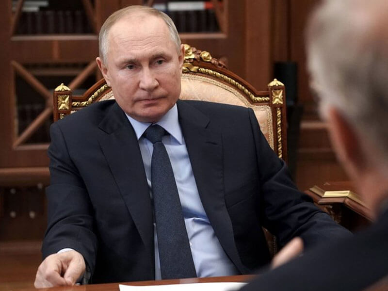 Putin signs law allowing him 2 more terms as Russia's leader